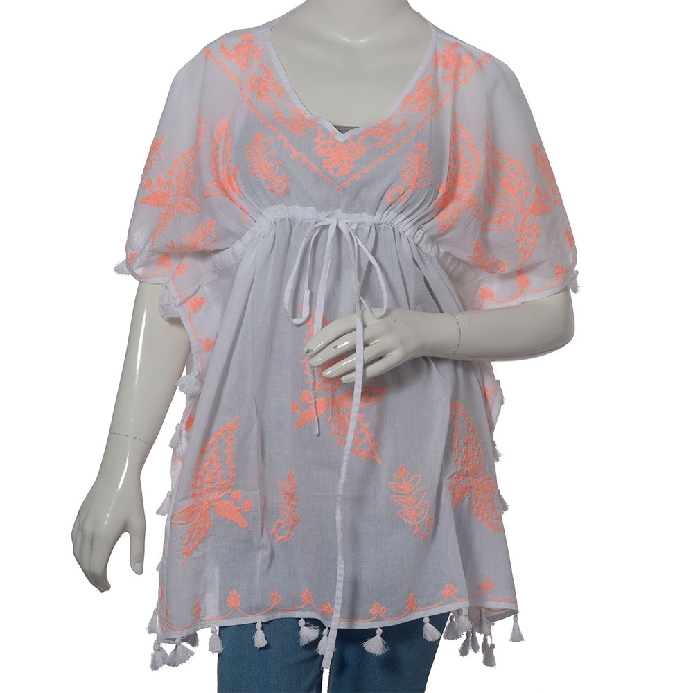 Peach and white beach cover up on mannequin against white background.
