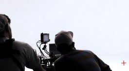 Two directors behind a video camera