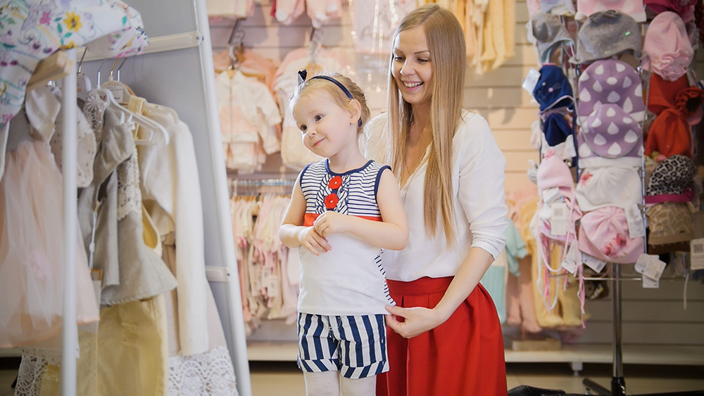 Mom and daughter shopping for new clothes.