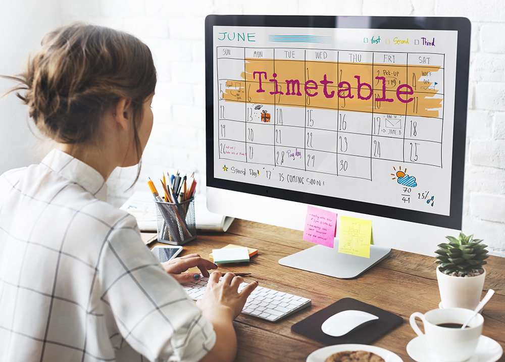 Woman planning her schedule using a computer.