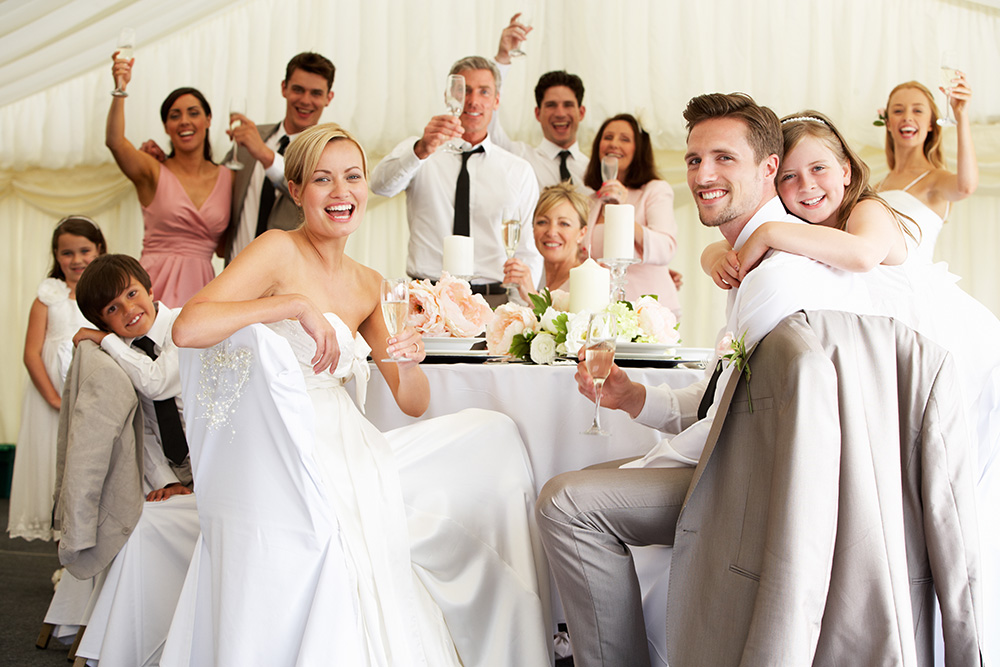 Wedding couple surrounding with loving guests.