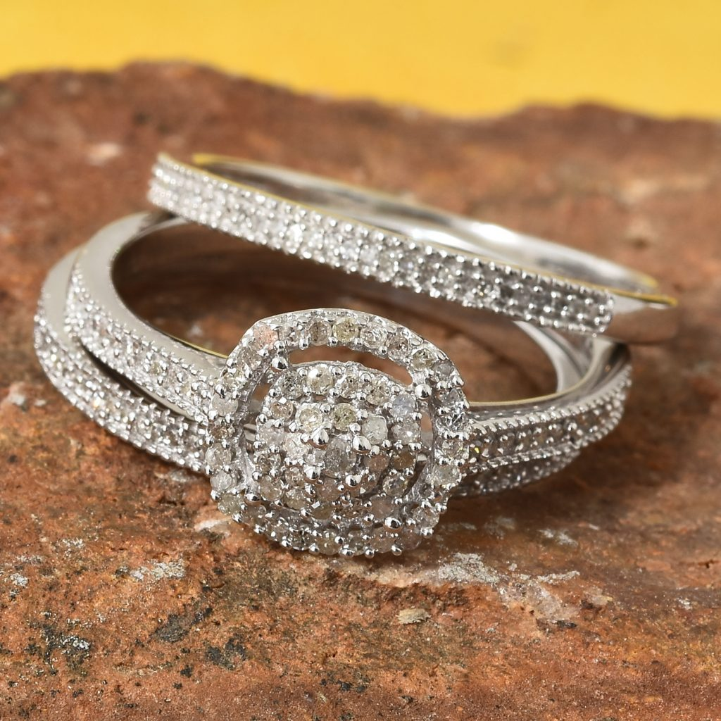 Closeup of diamond rings laid on a brown rock
