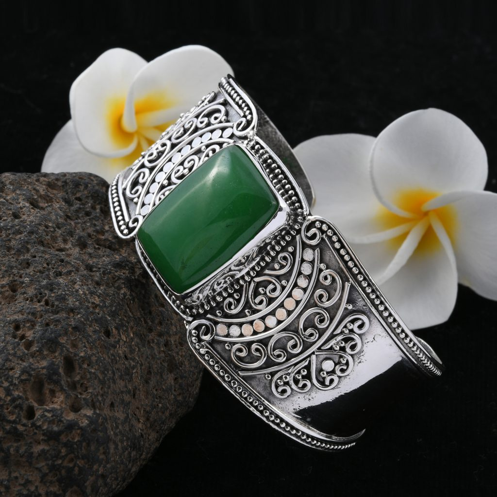 Closeup of jadeite bracelet set in silver