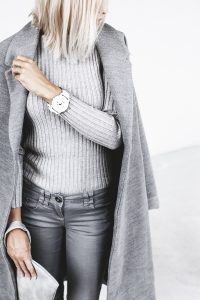Closeup of woman wearing a grey outfit ensemble.