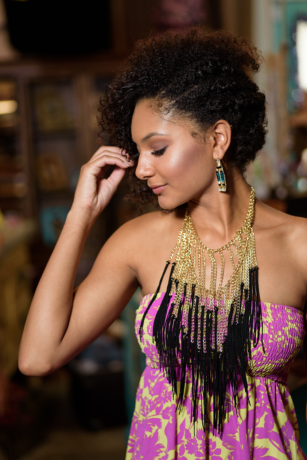 woman wearing strapless dress with dramatic necklace