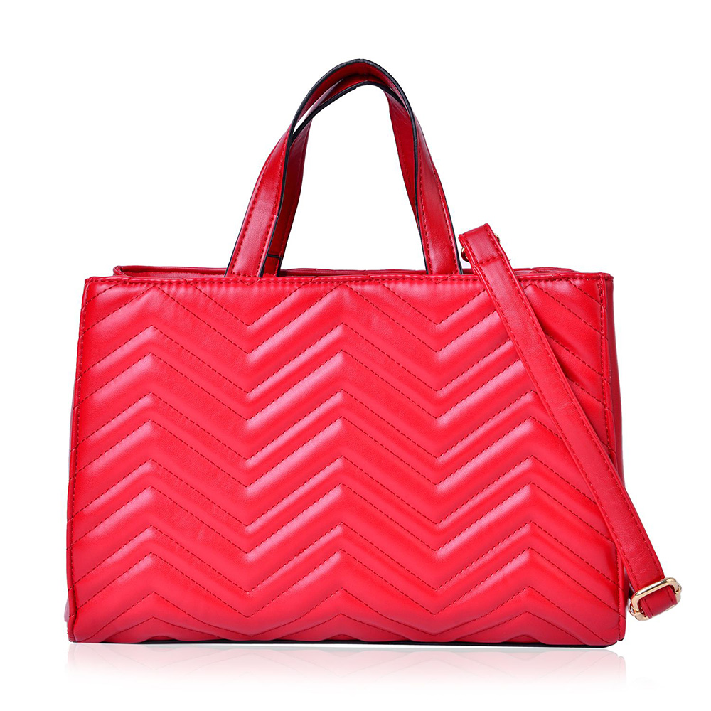 Red handbag against white background