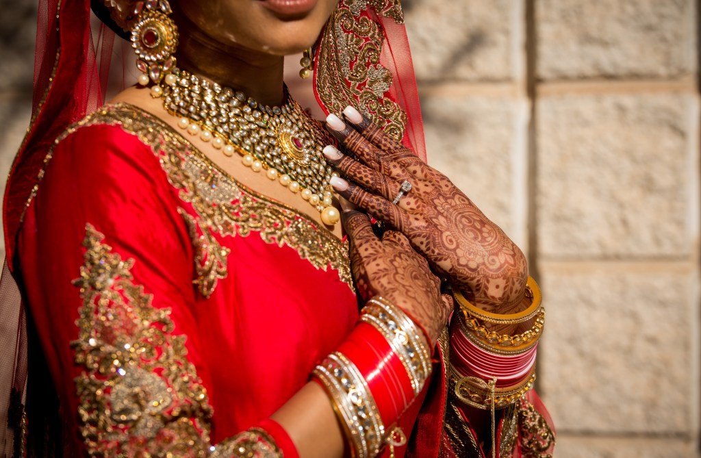 Bride displaying traditional jewelry and dress.