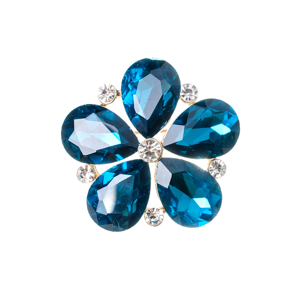 Closeup of blue flower gemstone brooch