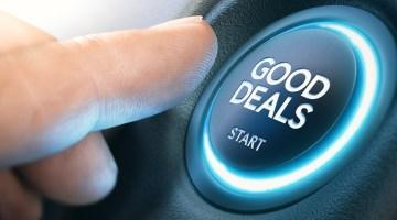 """Finger pushing """"Good Deals"""" button"""