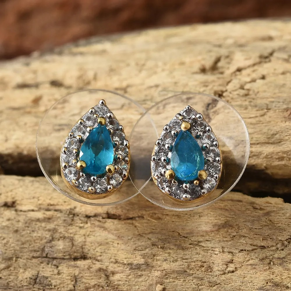 Apatite stud earrings against wood background