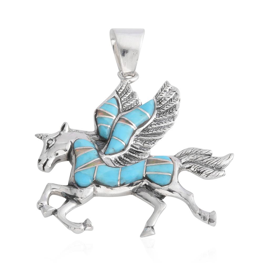 Closeup of turquoise unicorn pendant