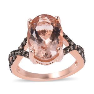Pink morganite ring on white background.