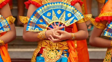 Balinese dancers holding fans