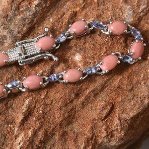Oregon peach opal bracelet resting on red rock.