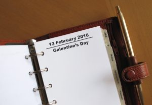 A calendar planner open to February 13th, Galentine's Day.