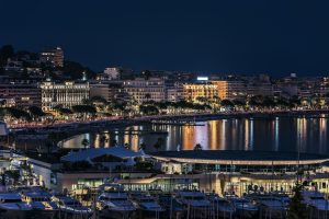The coast of Cannes, France at night.