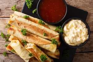 Lightly grilled bean taquitos with dipping sauces.