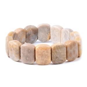 Beige coral stretch bracelet on white background.