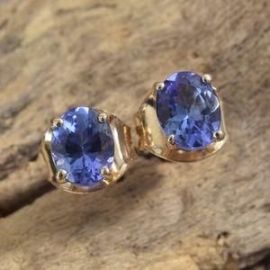 AAA tanzanite post back earrings in yellow gold.