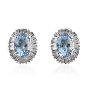 Sterling silver stud earrings with aquamarine gemstones.