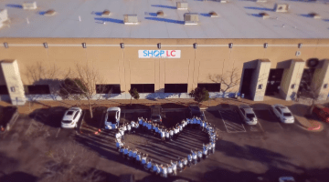 Shop LC employees creating a large heart in from of the Shop LC offices.
