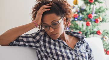 Woman experiencing holiday stress.
