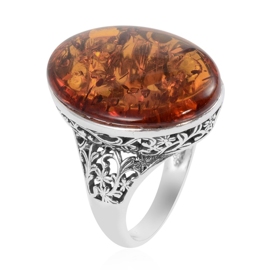 Amber ring in sterling silver with filigree on shank.