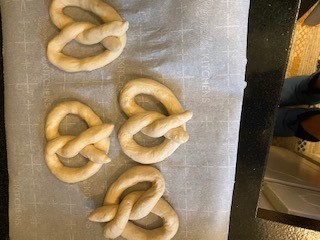 Pretzels reading for baking after twisting into shape.