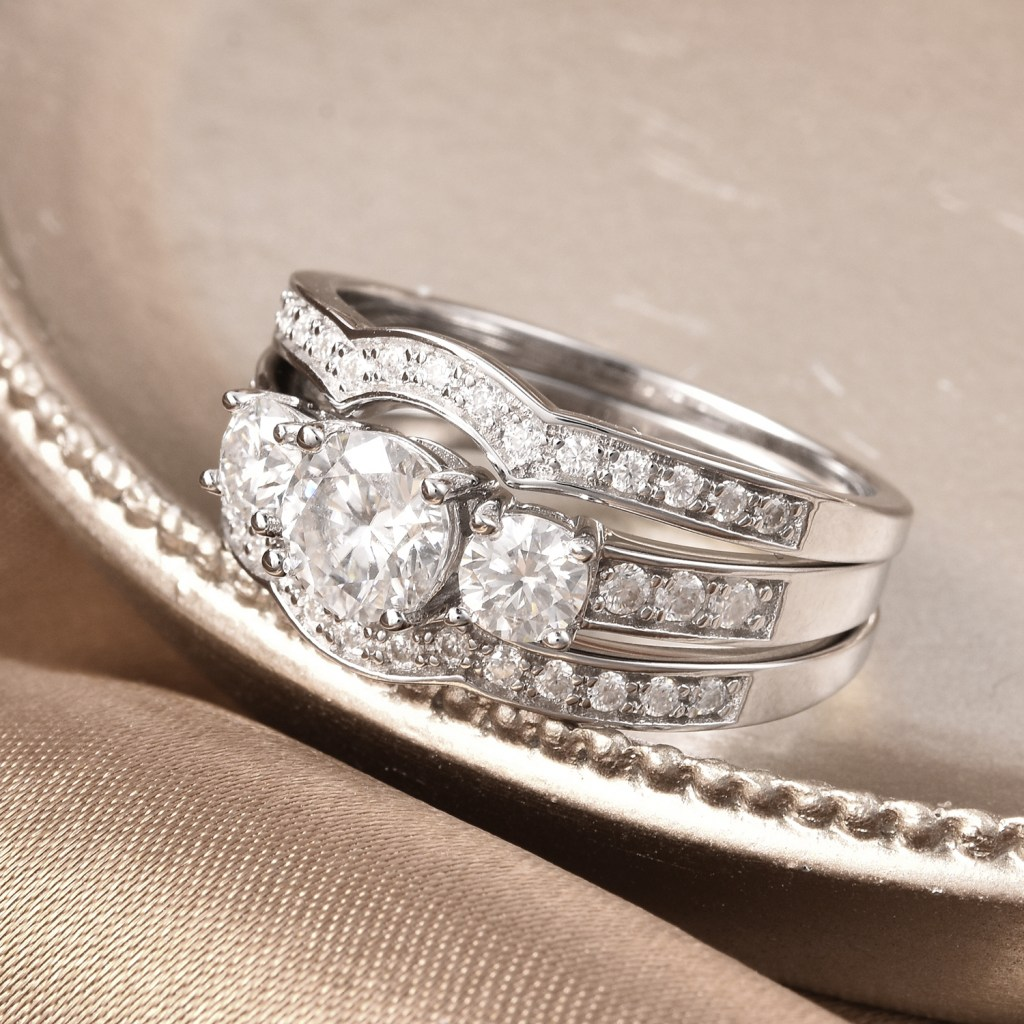 Moissanite 3 stone ring with enhancers.
