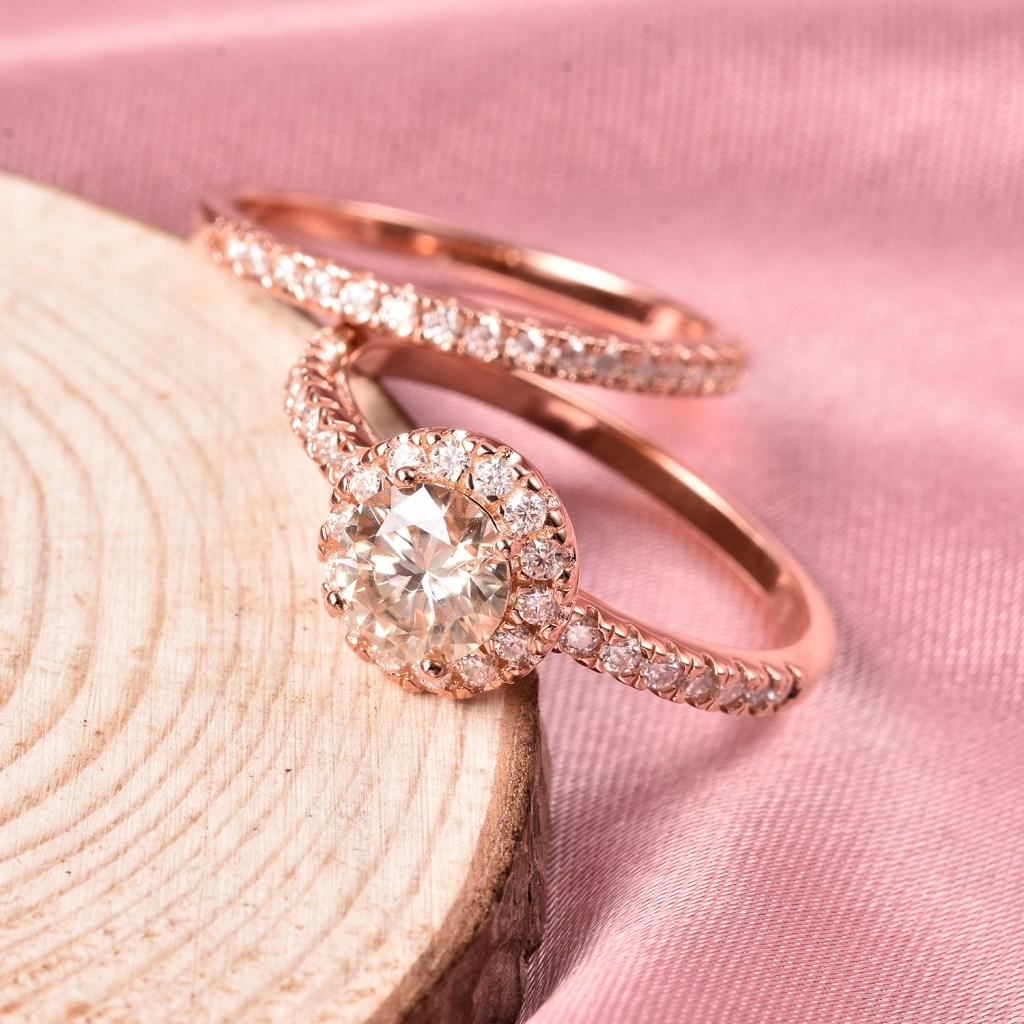 Moissanite two ring set in rose gold vermeil.