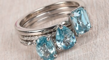 Stack of blue zircon rings.