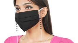 Woman wearing face mask neck chain.