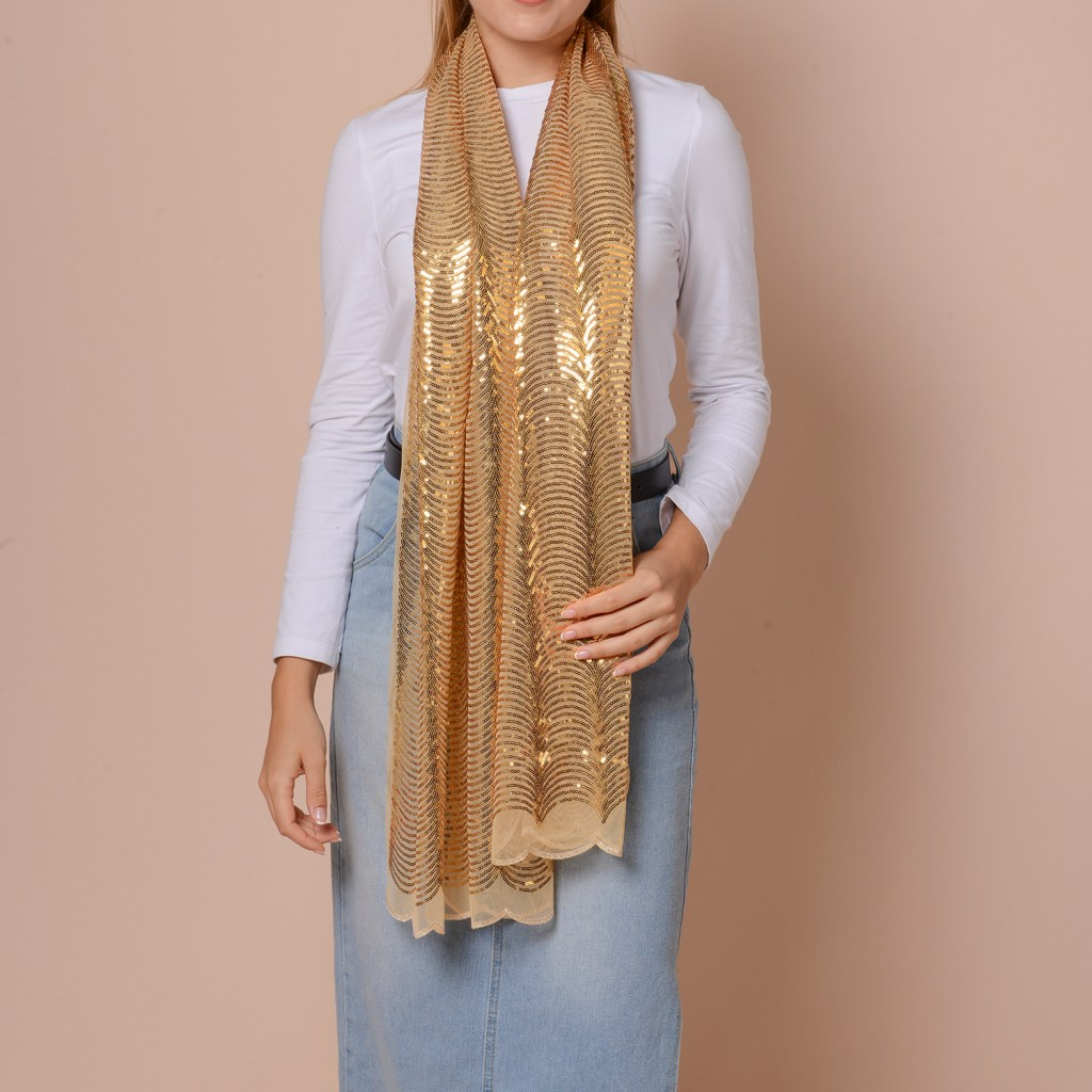 Woman wearing gold sequin scarf.