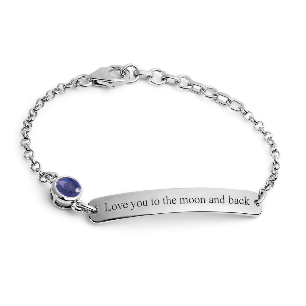 Bracelet inscribed with 'Love your to the moon and back'.