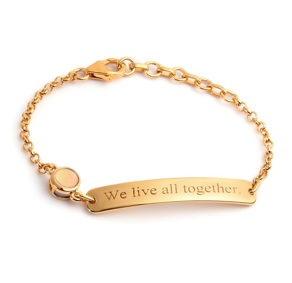 Gold bracelet with inscribed motto.