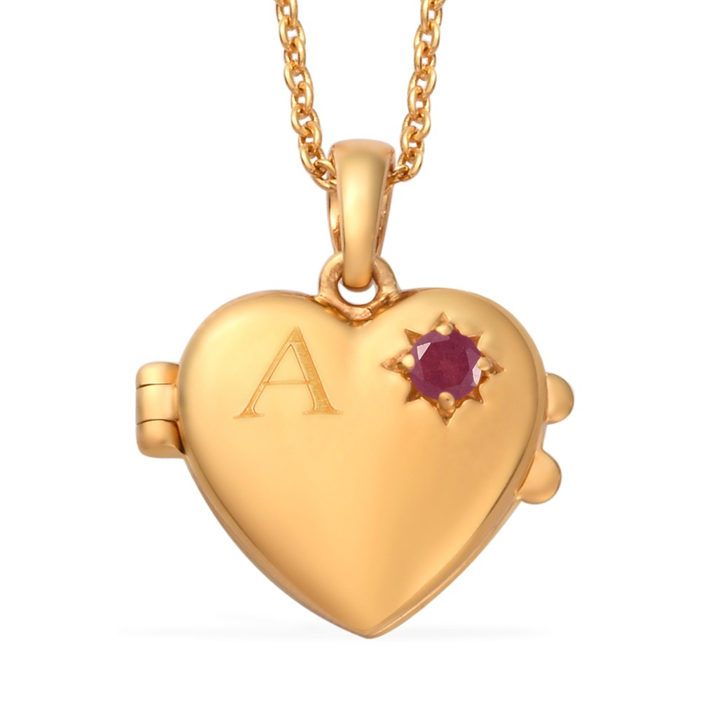 Gold heart pendant with initial and ruby birthstone accent.