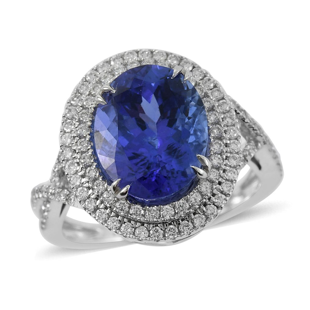 Blue gemstone ring with double diamond halo in white gold.