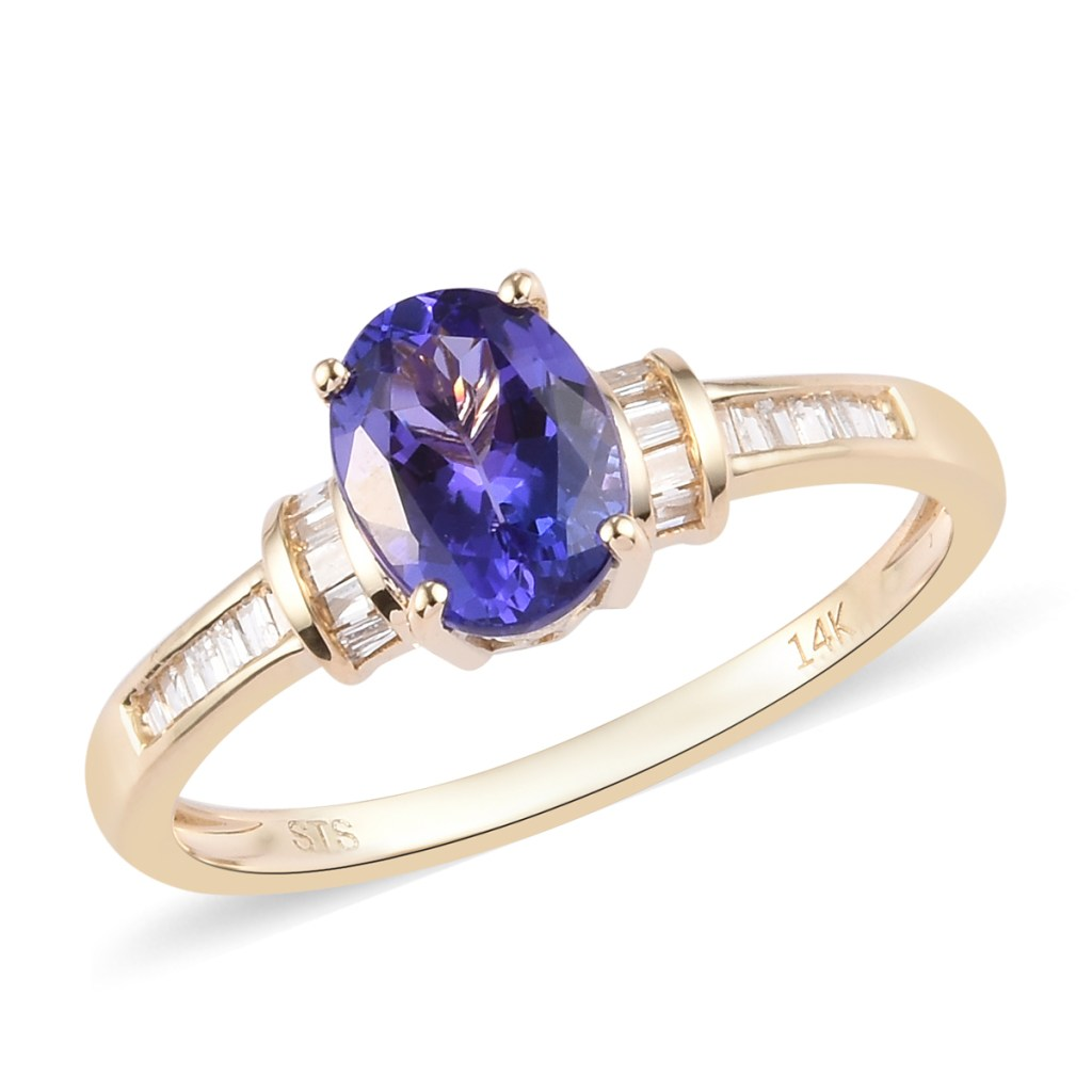 14K gold ring with blue gemstone.