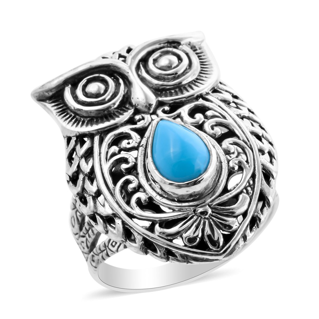 Turquoise owl ring.