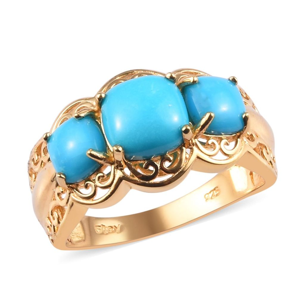 Blue three stone ring in yellow gold.