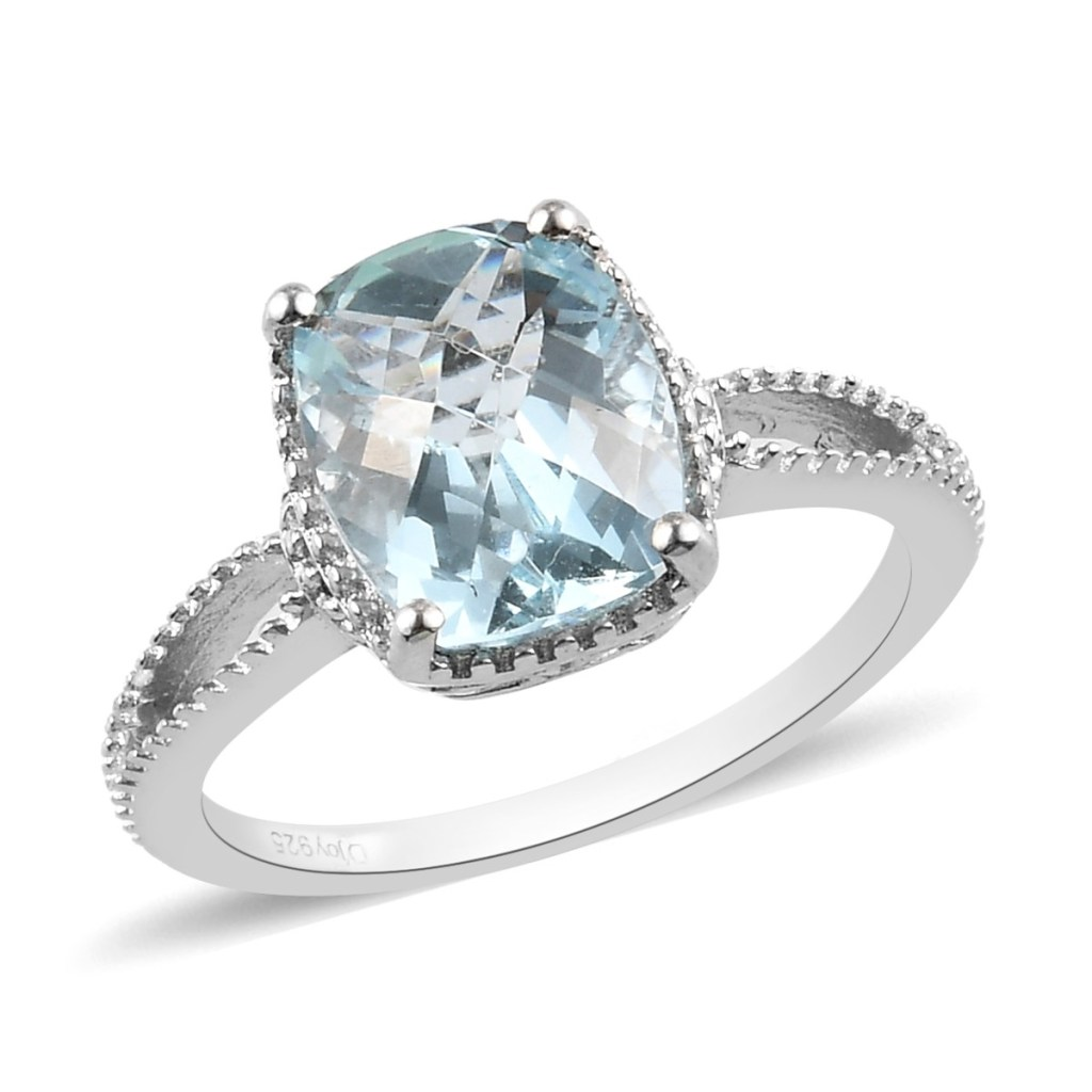 Sterling silver ring with light blue gem.