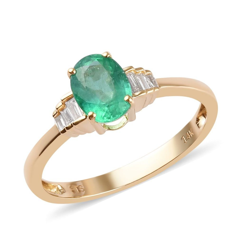 Emerald solitaire ring in 14K yellow gold.