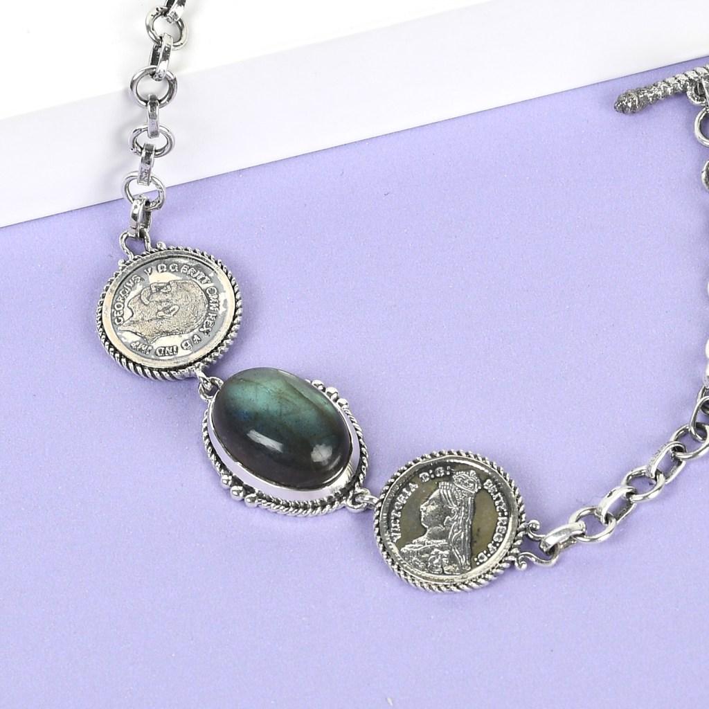 Sterling silver coin bracelet.