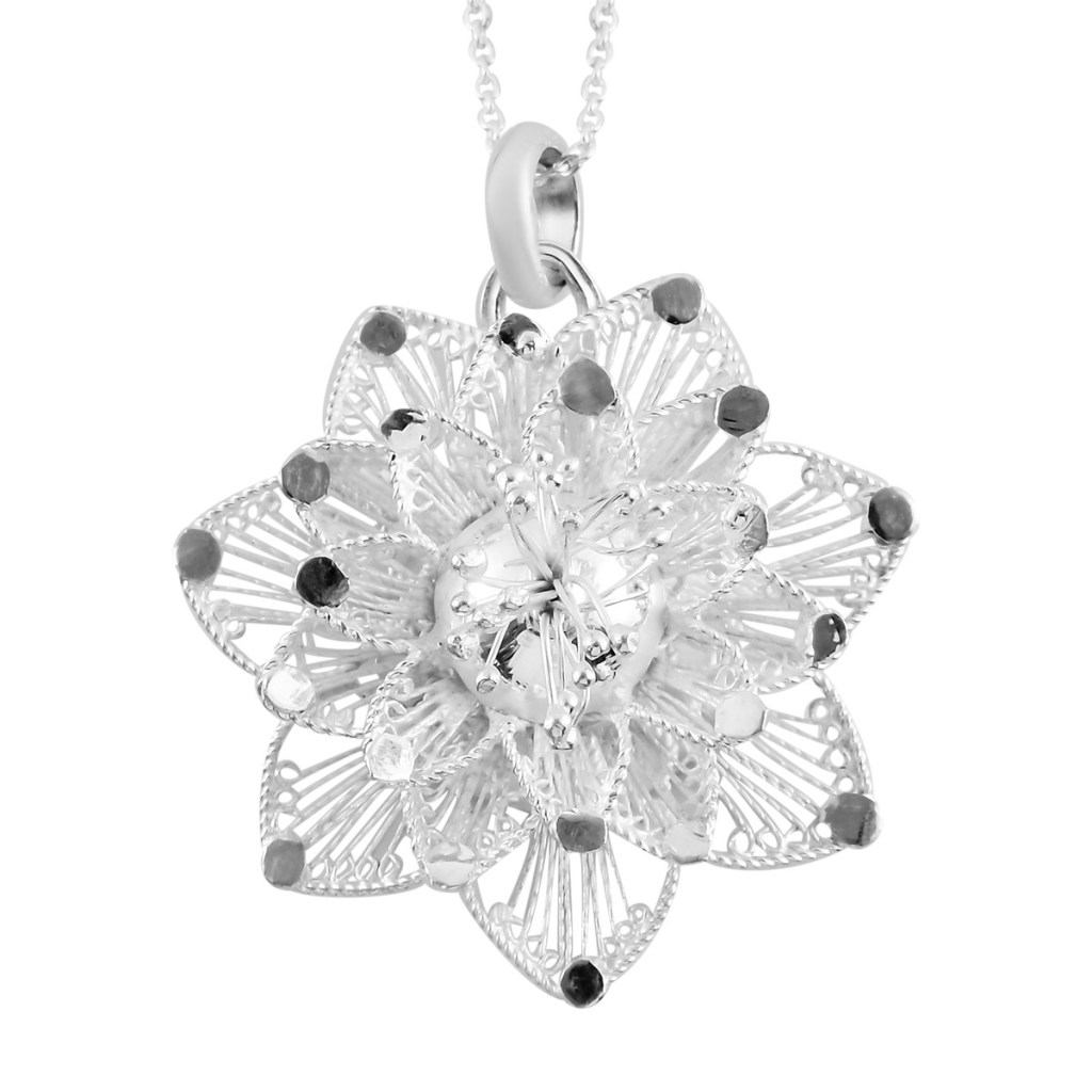 Sterling silver floral pendant.