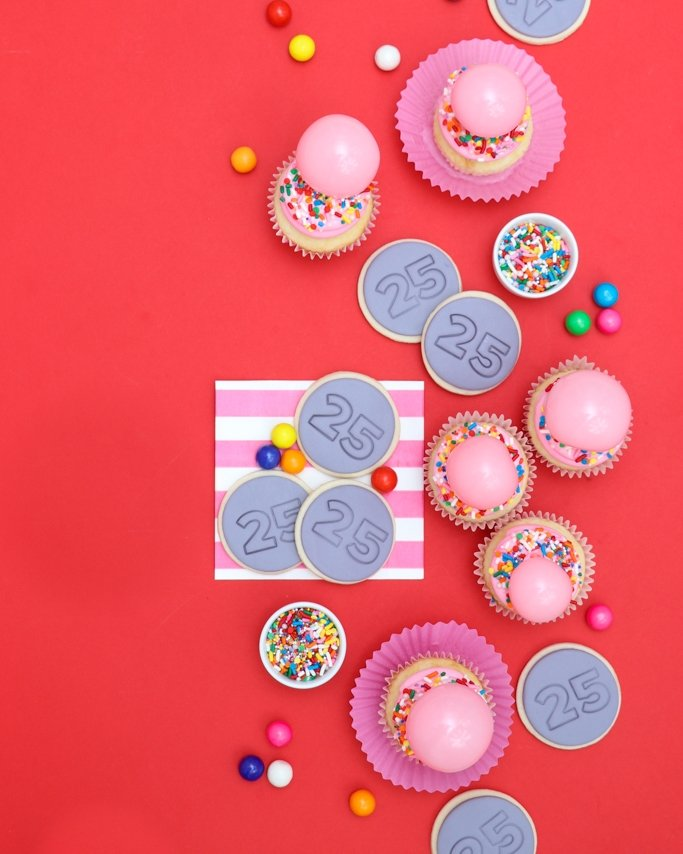 Bubble gum cupcakes and 25 cent quarter cookies on red background - Valentine's Day Party Ideas - Bubble Gum Party Ideas