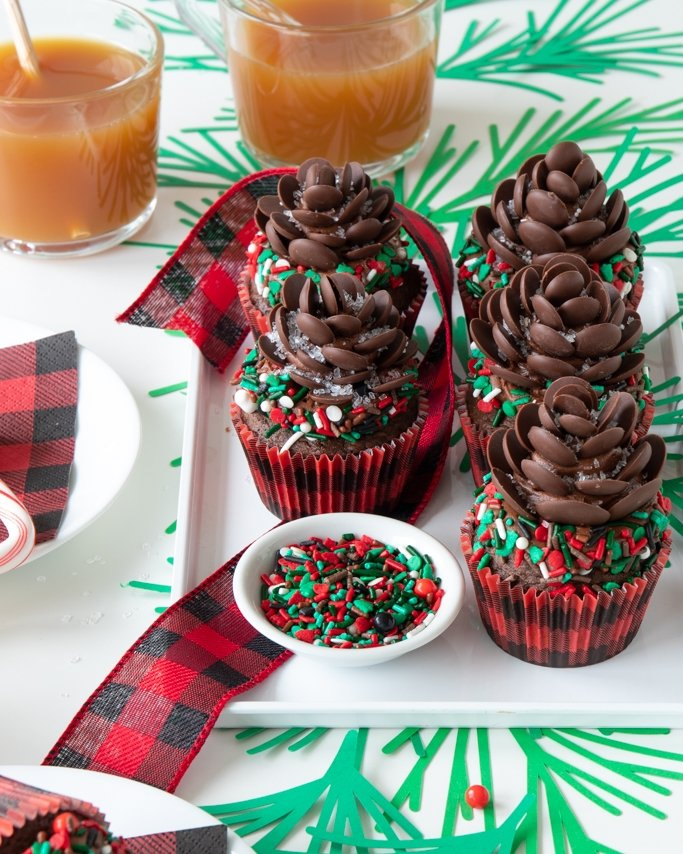chocolate pine cone cupcake in buffalo plaid cupcake liners on white dish