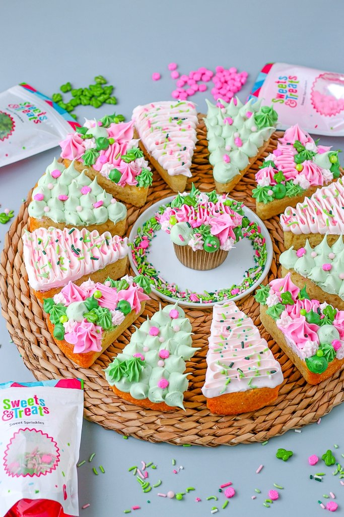 Cake pizza arranged in a circle around a cupcake also decorated with the same decorating techniques.