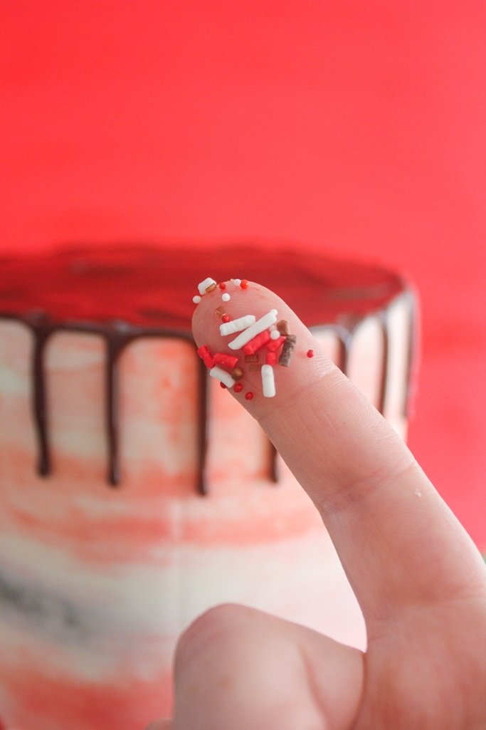 easily place sprinkles on drip cake drips before they dry on the side of the cake
