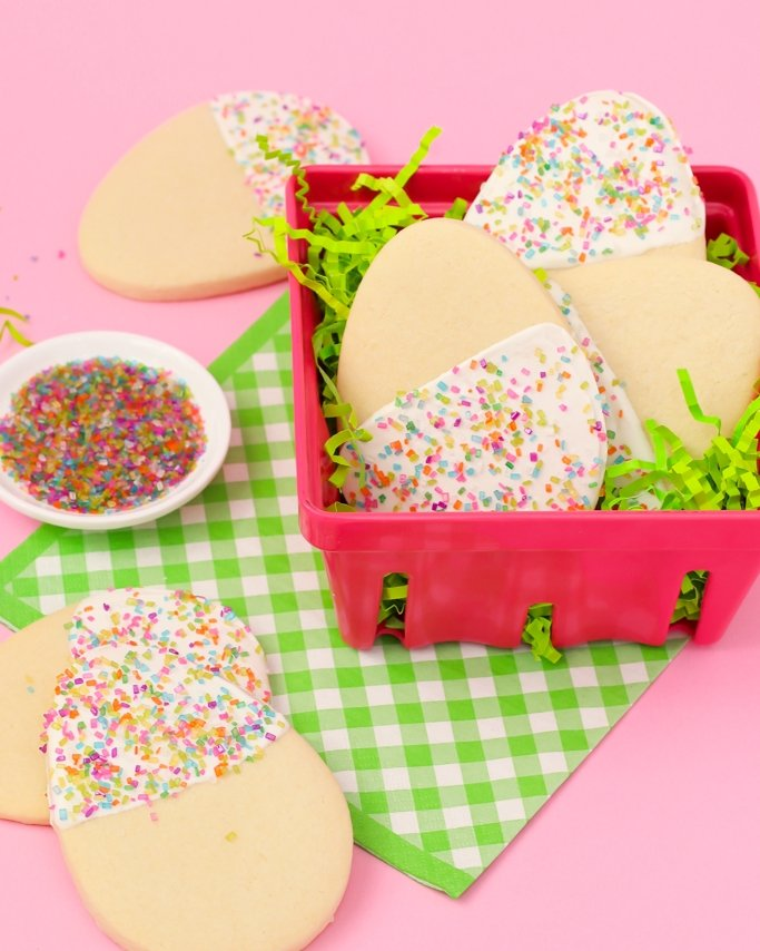 egg cookies with sprinkles in a pink basket