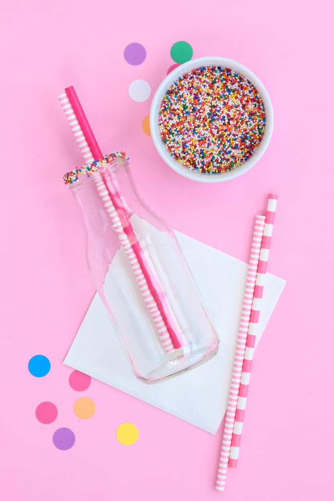 circus animal cookies party - Sprinkle rimmed glasses with paper straws inside and out